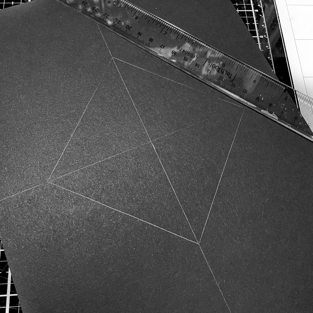 Center lines and middle square drawn with pencil on black card stock