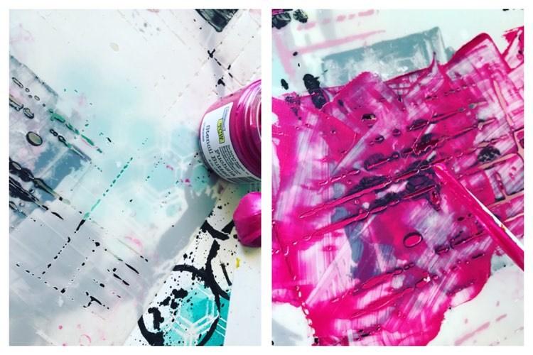 swiping fuchsia stencil butter through a grid stencil