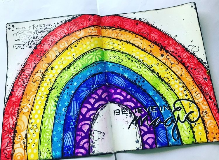 completed art journal page of a rainbow and lots of stencil work. Tammy Klingner Tambarambaa #tcwstencillove