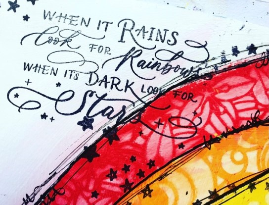 stamped quote when it rains look for rainbows, when its dark look for stars in top left corner of page