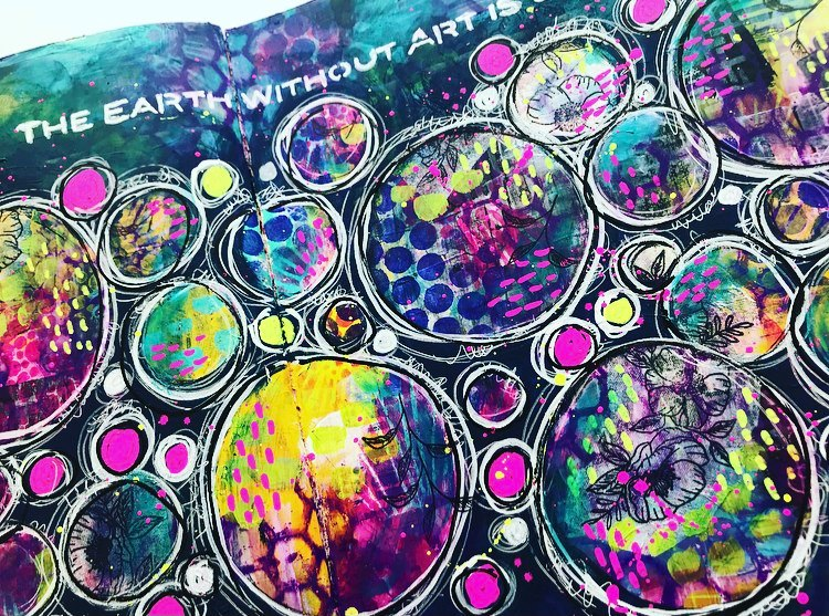 art journal page with lots of circles in navy, pink, yellow, blue, white