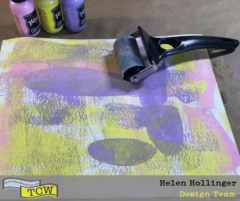 Using TCW9051 watercolor paper, add a few drops of acrylic paints (I used pink, yellow and purple) and a brayer to smoosh the colors around until you are happy with how they look.