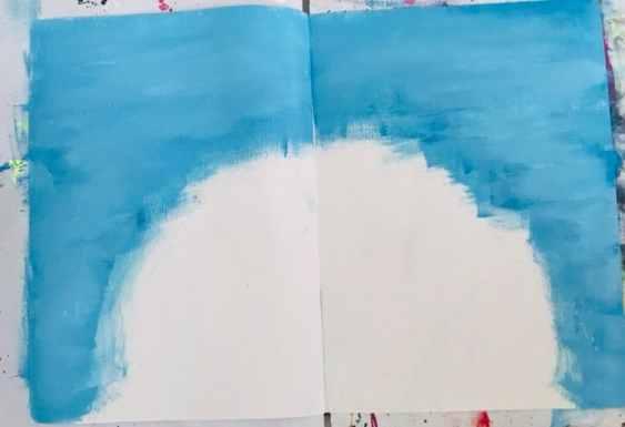 blue paint on art journal