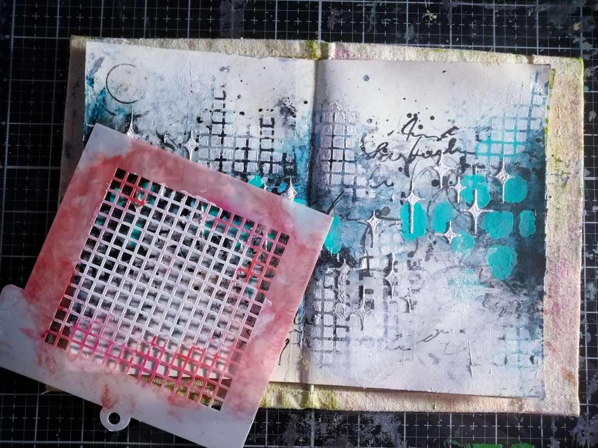 Art journal background stenciling with acrylic paints