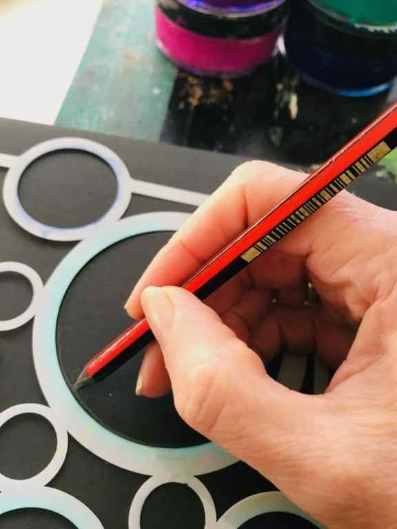 tracing a circle on a stencil for the moon