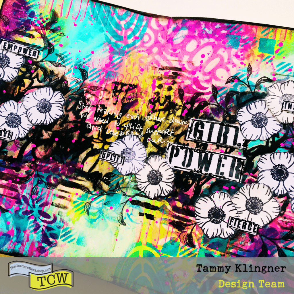 Art Journal page featuring bold colors and lots of layers of stencils with black and white flowers running across the page