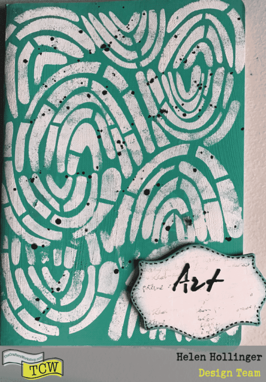 """I painted the cover of my art book insert with the blue green acrylic paint, and used a sponge through TCW941 Rainbow Montage stencil. I then splattered black ink over the whole thing. For the main tag for the front of my journal I used TCW9001 White gesso and covered it all, stamped and inked and doodled the edges. I used the word """"ART"""" from TCW261 Art Is stencil and TCW9009 Black Modeling Paste and spread the paste through the stencil with a palette knife."""