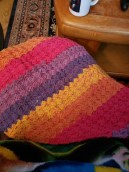 Crocheted wrap draped over my lap.