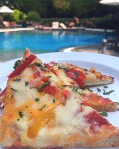 Pizza by the pool at Hyatt Regency, Mumbai.