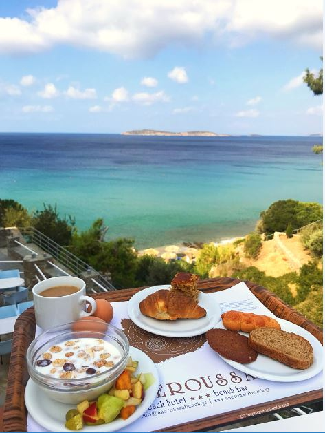 Breakfast with a view at Aneroussa Beach Hotel, Andros, Greece.