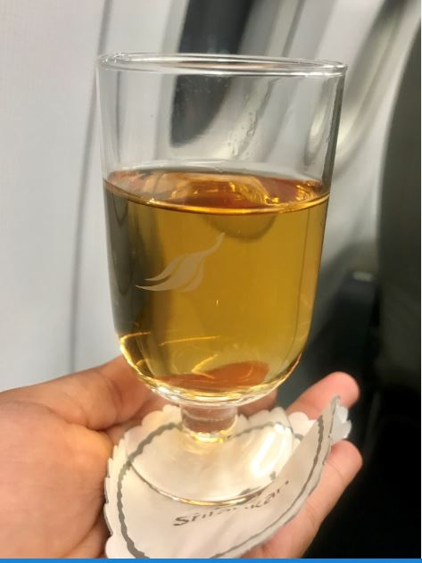 Greeted by Apple juice and warm towels on board Sri Lankan Airlines.