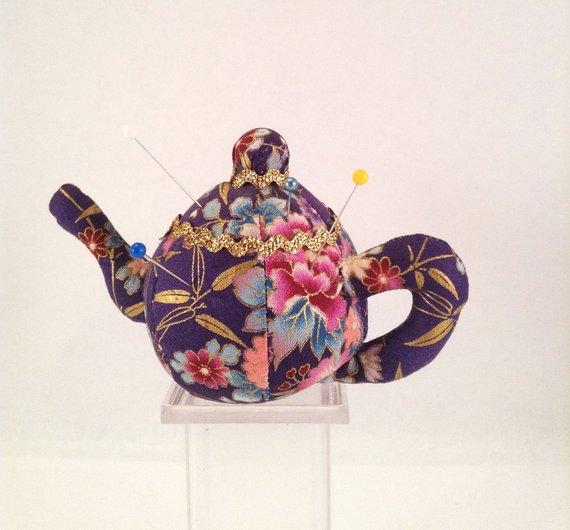 a teapot pin cushion