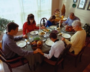 Family Praying Before Dinner