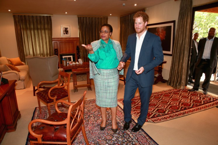 Prince Harry with Graca Machel, the widow of Nelson Mandela, at the Nelson Mandela Centre for Memory. Picture by i-Images / POOL.