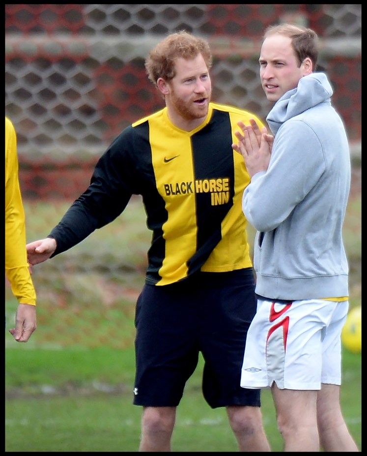 william and harry warmed up on the pitch before the traditional christmas eve football match - Football Christmas Eve