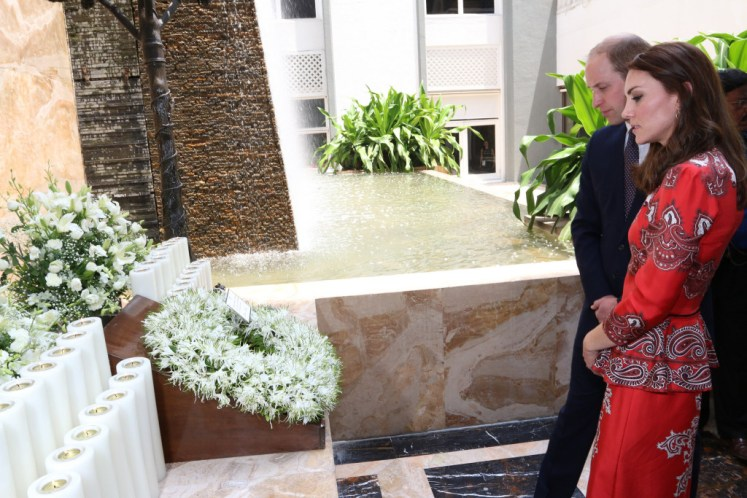 William and Kate laid a wreath of lillies at the hotel memorial. UK in India