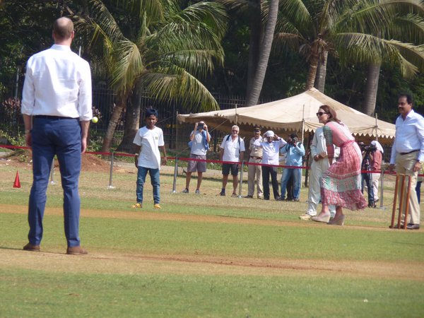 William bowls to his wife, Catherine, as they play cricket in Mumbai. Rebecca English/Daily Mail