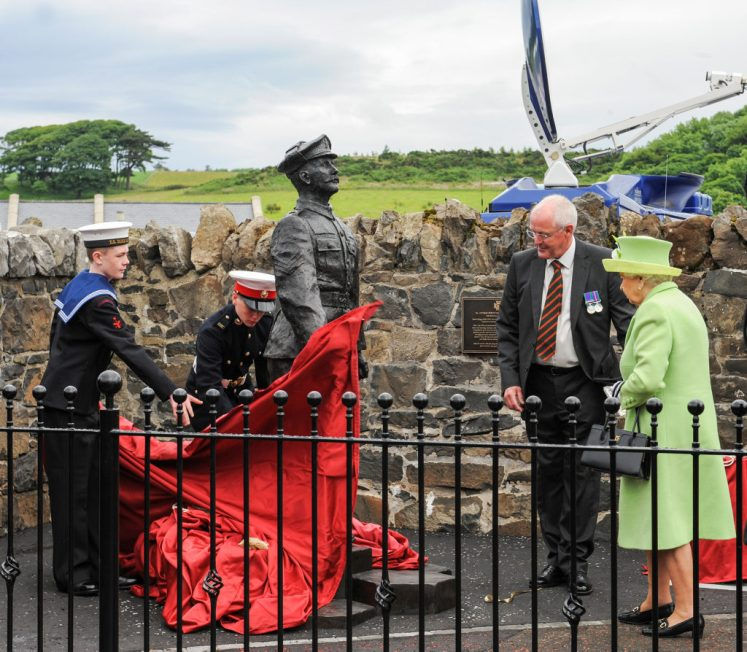 The Queen and Duke of Edinburgh unveiled a statue to local Victoria Cross winner Robert Quigg whilst visiting the town of Bushmills. (Ministry of Defence/Kellie Shattock)