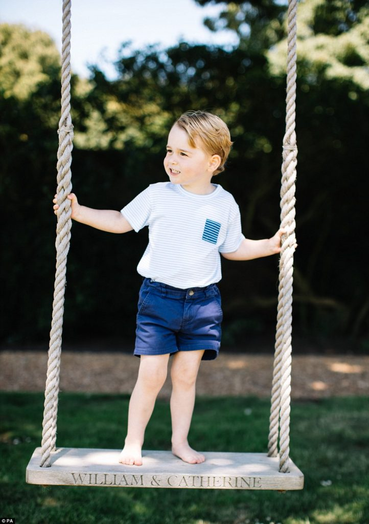 Prince George stands on a swing at Anmer Hall
