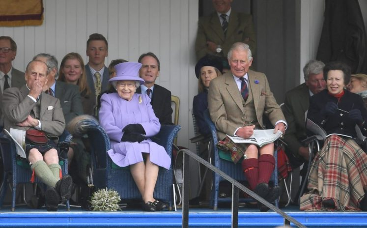 The Queen, joined by Prince Philip, Prince Charles, and ,Princess Anne at The Braemar Gathering in the Scottish Highlands. Picture by Andrew Parsons / i-Images