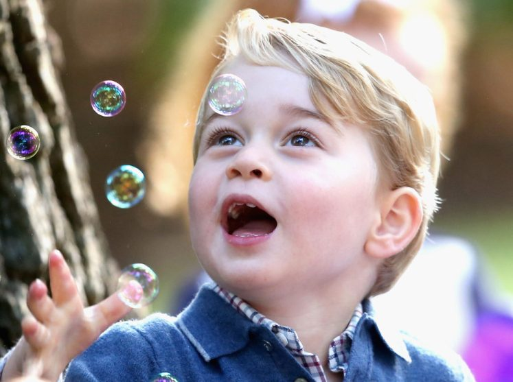 Prince George loved the bubbles at the party (Splash News)