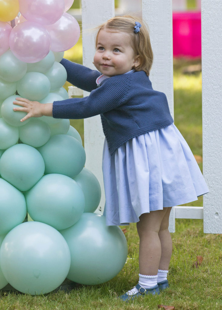 Princess Charlotte spent most of her time with the balloons, trying to pop them. (Splash News)