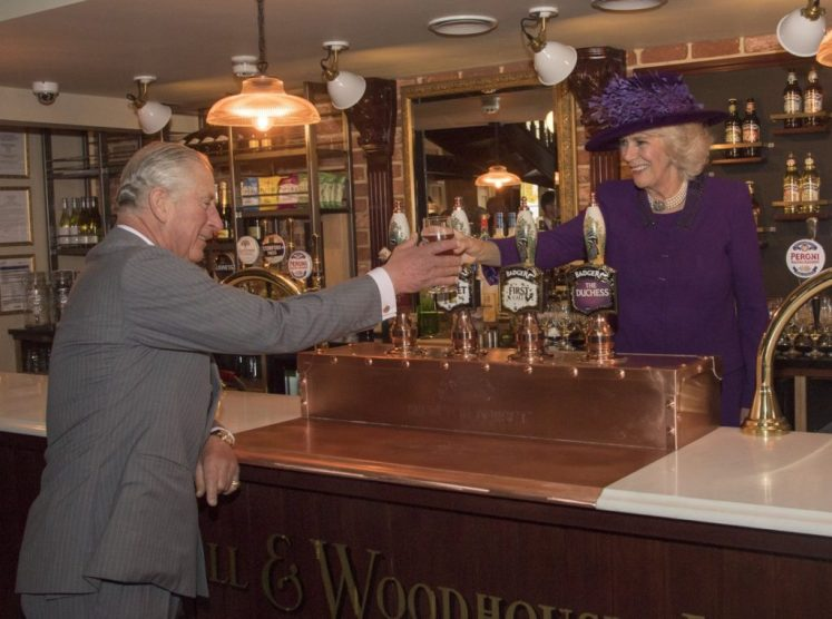 Camilla pulls a pint for Prince Charles at The Duchess of Cornwall Inn in Poundbury (@ClarenceHouse)