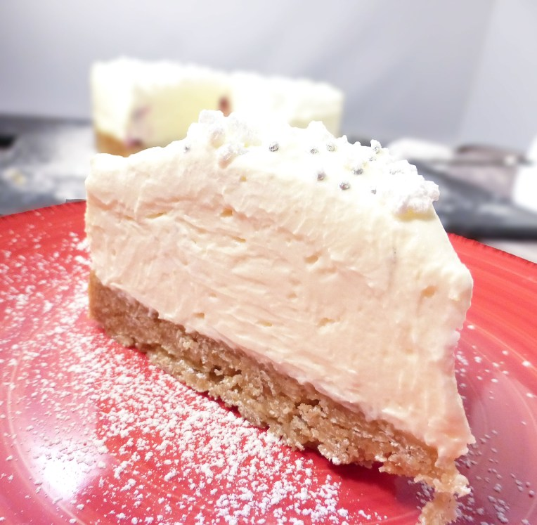 This dessert has a filling which is light and terrifically and is sweet made with mascarpone, cream cheese and white chocolate. There's also a smattering of cranberries to add an extra dimension to the taste and a seasonal touch. Lastly, a layer of whipped cream topped with wintery decorations and a sprinkle of icing sugar finishes off the look.