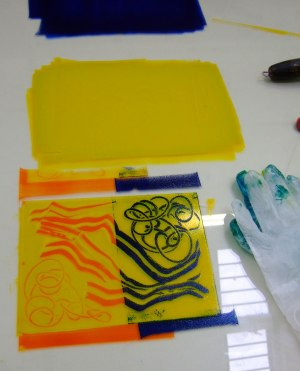 viscosity printing; mono print in blue, yellow and orange