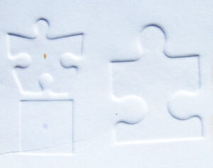embossed jigsaw pieces
