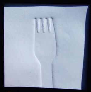 a wooden fork embossed