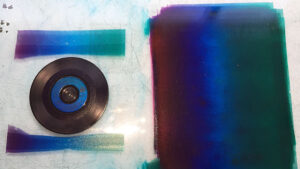 inking the vinyl record with a roller