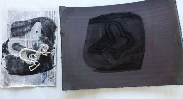 The impression left in the paint before printing