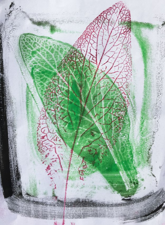 a red leaf printed over a green leaf