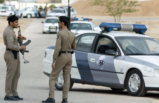 Saudi security personnel stand guard in Riyadh AFP/File, Hassan Ammar