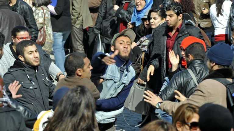 """Islamist students attack students of the Bourguiba Language Institute in the El Khadra neighbourhood, a Salafist bastion, of the capital Tunis, as they try to prevent the filming of current Internet craze the """"Harlem Shake"""" (AFP Photo )"""