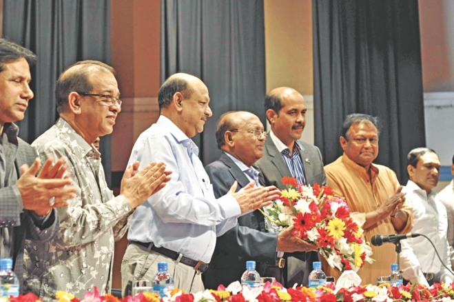 Fourth from left, Tofail Ahmed, commerce minister, attends a meeting at the Bangladesh Garment Manufacturers and Exporters Association office in Dhaka yesterday. Atiqul Islam, BGMEA president, was also present.  Photo: Star