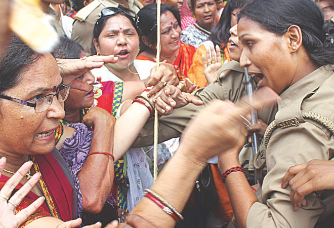 Indian Bharatiya Janata Party demonstrators argue with policewomen during a protest against the recent gang-rape and murder of two girls, in Lucknow yesterday. Indian police fired water cannons at a group of mainly women protesting against the gang-rape and lynching of two girls in the country's largest state. Photo:AFP