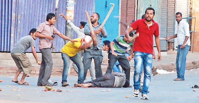 Goons belonging to Bangladesh Chatra League beat up an opposition supporter. Photo: Star File