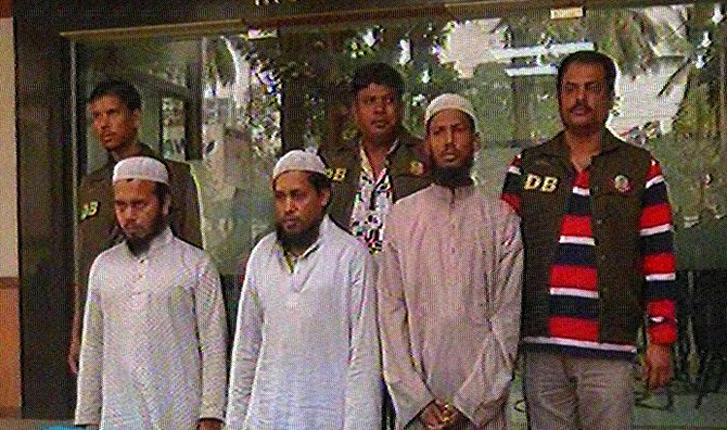 Detectives produce three JMB men, arrested Sunday night, before newsmen at Dhaka Metropolitan Police media centre in the capital. Photo: TV grab