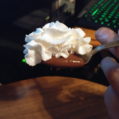 A spoon full of Nutella and Whipped Cream
