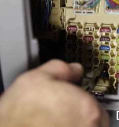 image pulling a fuse out of a fuse box [ 1920 x 1080 Pixel ]