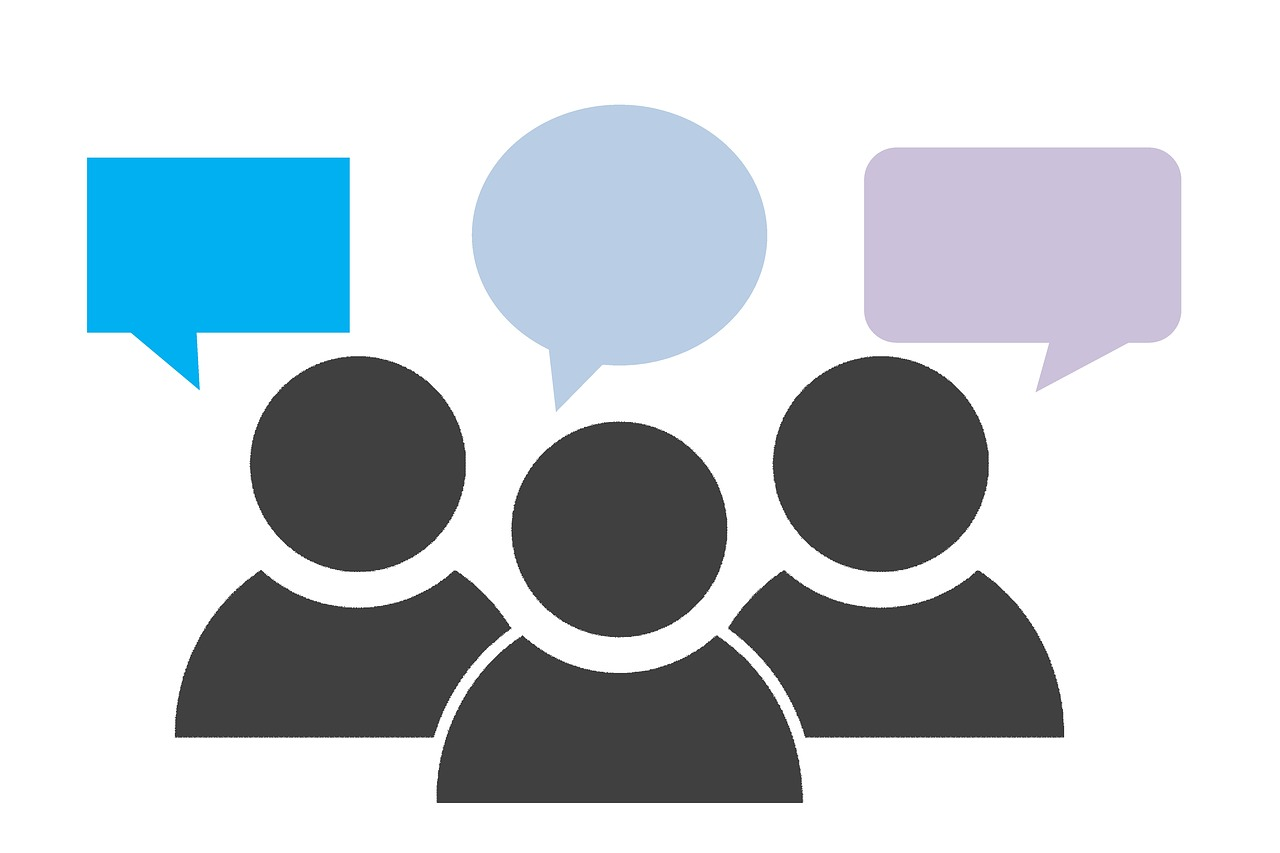 group of figures with blank speech bubbles over their heads