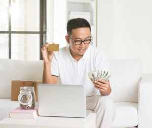 Man Getting Cash Back on Credit Card Purchase