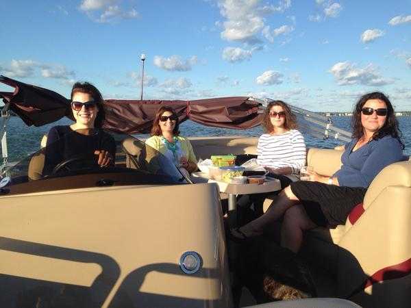 Authors on a boat from left to right: Susan Gloss, Erin Celello, Michelle Wildgen, Susanna Daniel