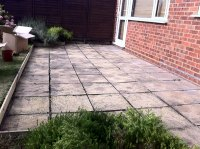 Transforming uneven patio slabs with Levato Mono pavers.