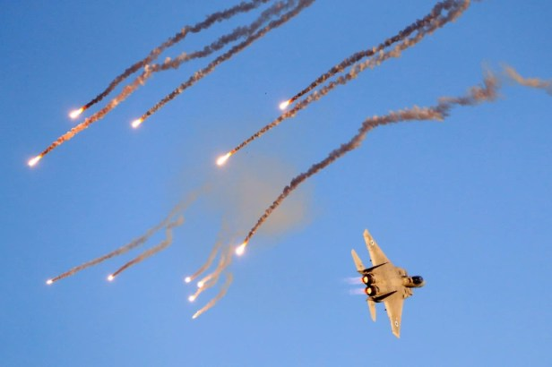 An Israeli F-15 I fighter jet launches anti-missile flares during an air show near the southern Israeli city of Beer Sheva