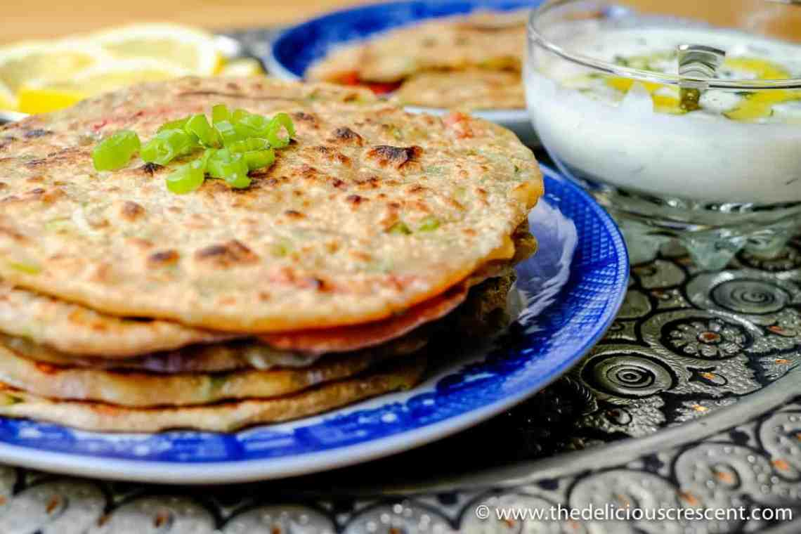Cheesy and Peppery Green Onion Paratha is a whole grain, flavor packed, scrumptious stuffed Indian flatbread. One serving – 213 kcals, 8 g protein, 4 g fiber.