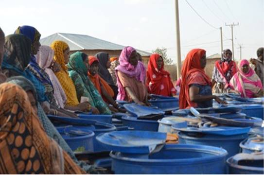 These women line up early to receive water during drought periods, with our water tanker remaining one of the only sources of potable water in the area at these times.