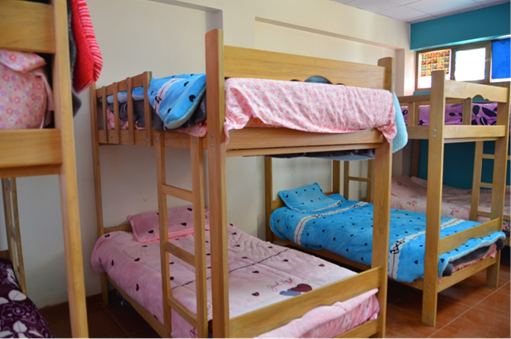 A clean and welcoming dormitory room in the new boarding school